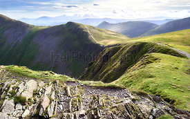 The rocky crags of Hobcarton leading to Grisedale Pike from gthe summits of Hopegill Head in the Lake District, England, UK.