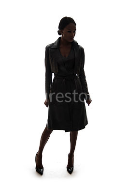 A silhouette of a tough woman, in a leather coat – shot from eye level.