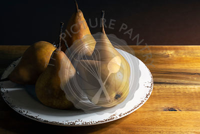 Ripe Bosc pears on a plate.