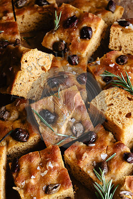 Delicious olive and rosemary pumpkin focaccia closeup