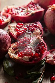 Pomegranates on wood background