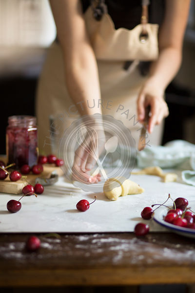 Woman making homemade croissants