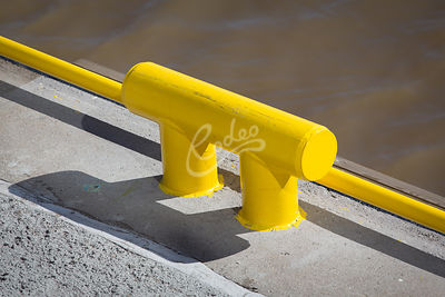 Yellow handle bar at the pier
