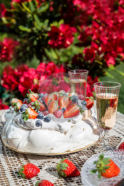 Pavlova with cream and fresh fruit