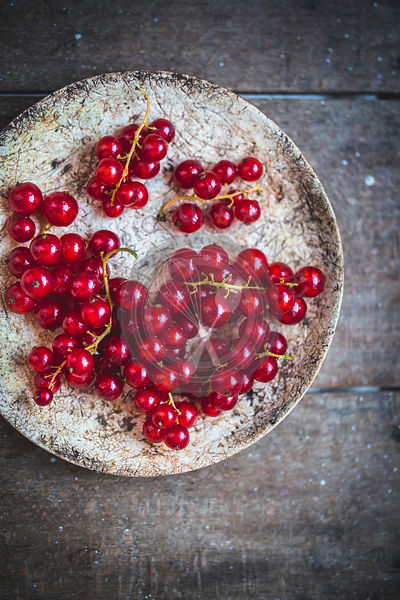 Redcurrants on a ceramic plate
