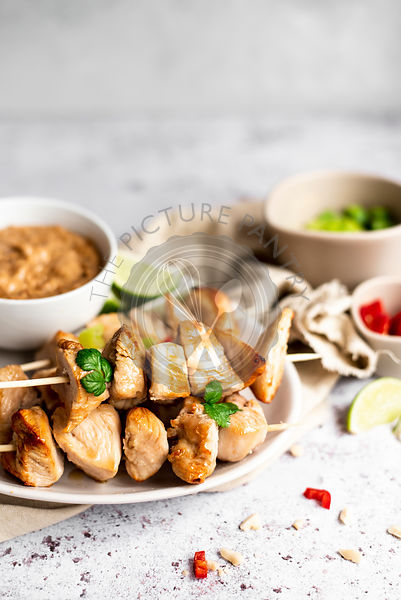 Chicken Skewers With Satay Sauce And Spring Onion And Chilli Pepper Sides