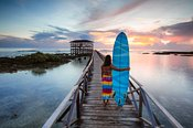 Woman with surfboard, Cloud 9, Siargao, Philippines