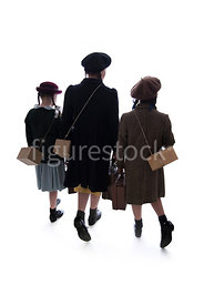 A semi-silhouette of three 1940's children walking together– shot from eye level.