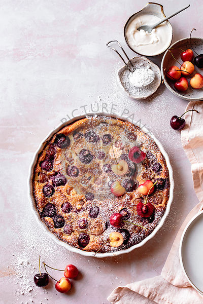 Cherry clafoutis dusted with icing powder.