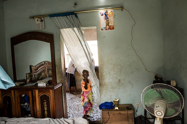 A little niece in the Mamadou's room, in the village of Soukouta, southern Senegal; he's a presumed victim of the wreck of Ap...