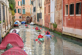 VENICE, ITALY - OCTOBER 25, 2017: City kayak tour within narrow canals around the city.