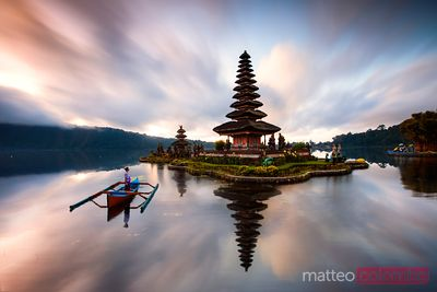 Woman on boat near Ulun Danu Bratan temple, Bali