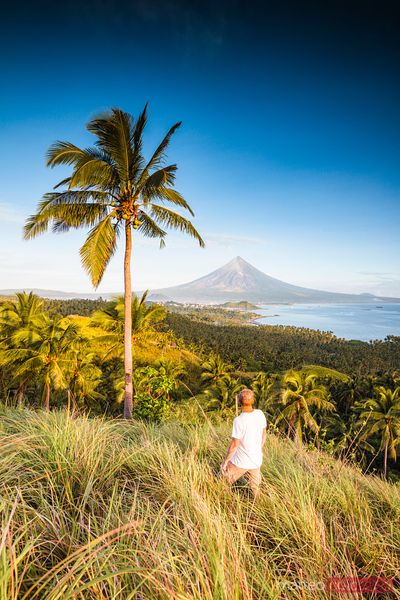 Man looking at Mayon volcano, Albay, Philippines