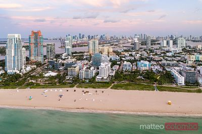 Aerial view of South beach and city at sunset, Miami