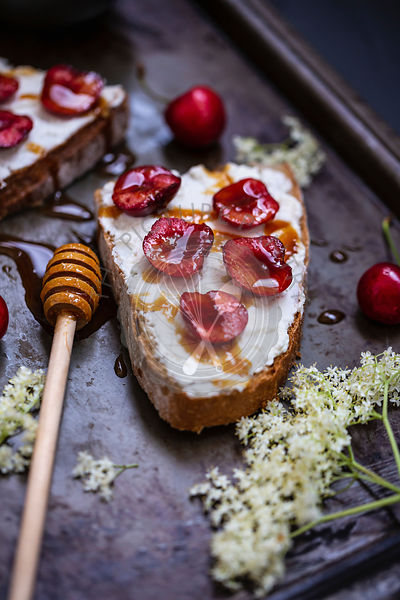 Toast with ricotta soft cheese, cherries and honey