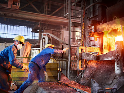 Industry, Smeltery, Workers checking blast furnace for fractures