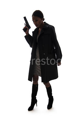 A Silouette of a tough woman witha gun – shot from eye level.