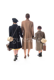 A 1940's woman walking with a boy and a girl – shot from eye level.