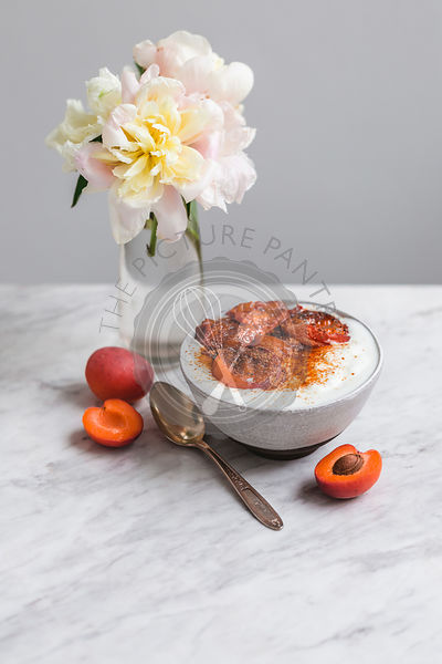 Bowl of yogurt with roasted apricots and coconut sugar