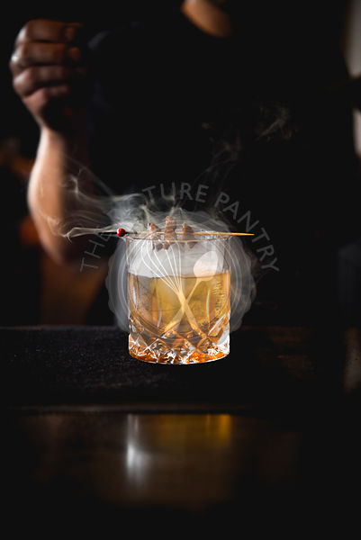 Smoking Cocktail on a bar with a bartender