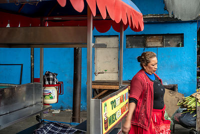 A woman carries shopping through the Mercado Terminal,
