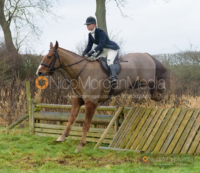 Marina Bealby jumping a hunt jump after the meet