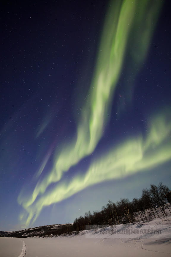 Aurora above the Tenojoki River in Utsjoki, Lapland, Finland