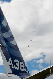 #121199,  Extra EA300 aircraft of The Blades aerobatic display team fly past the rear tail plane of an A380, Farnborough Air ...