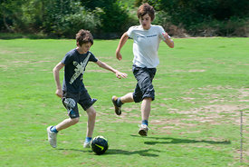 #73106,  Football on the field, Summerhill School, Leiston, Suffolk. The school was founded by A.S.Neill in 1921 and is run o...