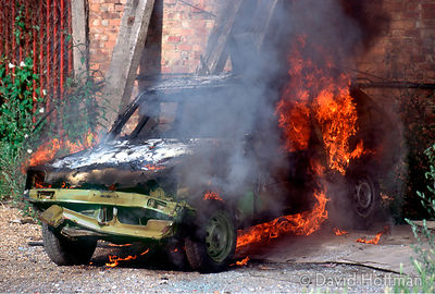 Stolen car, dumped and set on fire on wasteland by M42 motorway, West London.