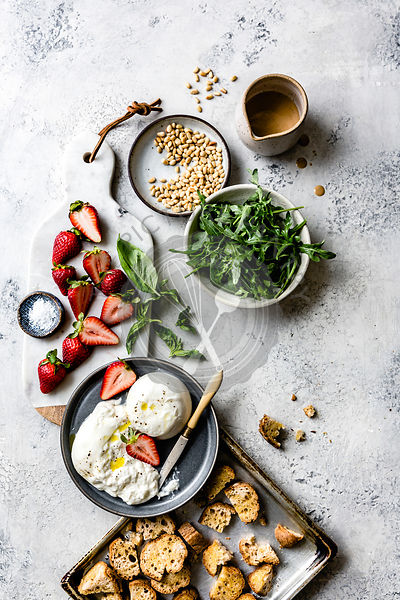 Ingredients for strawberry burrata panzanella salad.