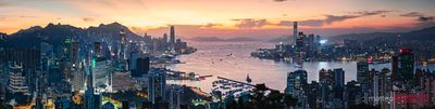 Panoramic sunset over harbour and skyline, Hong Kong