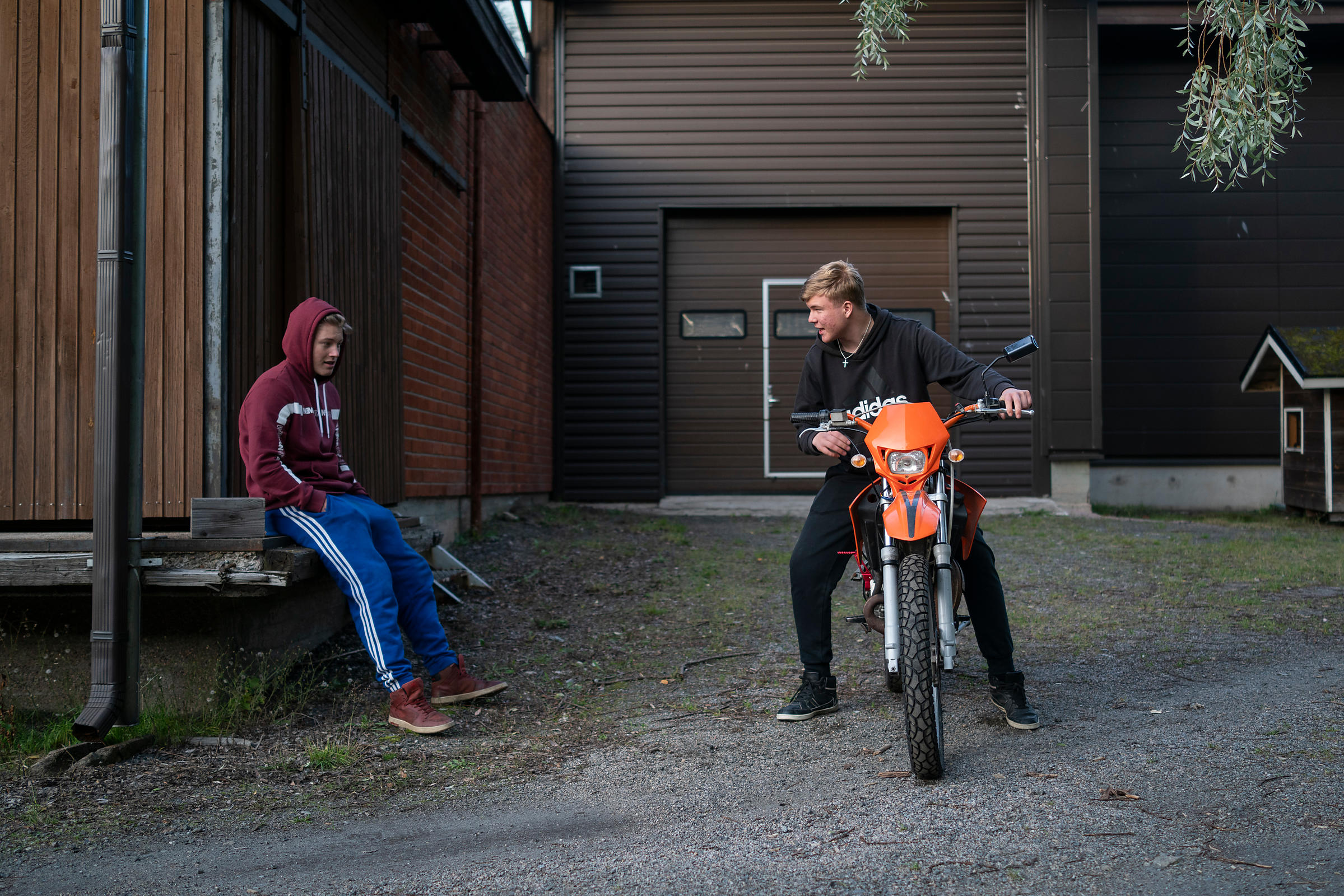 Touko Muinonen follows as Veikka Sointu finally gets his moped running at a moped workshop arranged by the municipality of Pe...