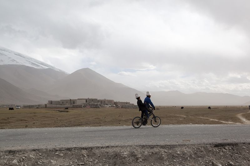 Local kirgiz people on a bicycle, Xinjiang
