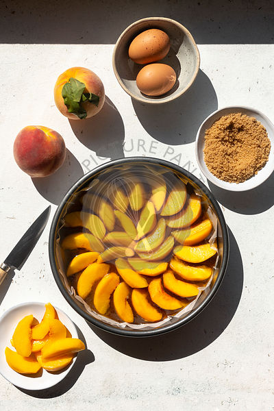 Preparing an upside down peach cake