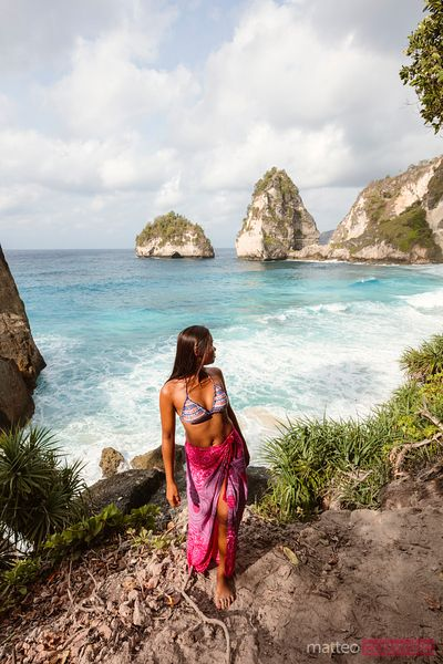 Asian woman at Diamond beach, Nusa Penida, Bali