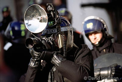 7.1/676 Police photograph Reclaim The Streets activists at a protest in Trafalgar Square. 1997.
