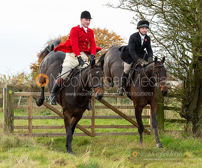 Miles Seston, Ben Hobday jumping a gate. The Middleton Hunt at Bugthorpe 9/11