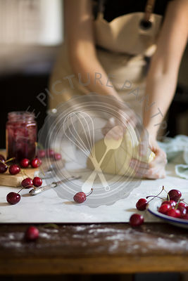 Woman kneading dough on the table