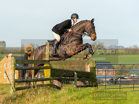 Alex Tordoff jumping a fence at Deane Bank - The Cottesmore Hunt at Owston 19/11