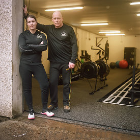 Emma and Colin, Wolfhouse Gym, Corpach, Fort William. Emma is British bench press record holder and co-founder of Wolfhouse Gym.