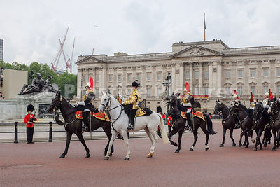 The mounted regiments of the Household Cavalry  troop past Buckingham Palace