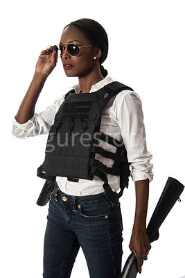 A tough woman, in a bullet proof vest – shot from eye level.