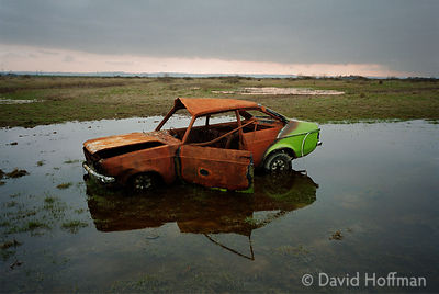Stolen car burned out & dumped by joy riders on Cooling Marshes near Cliffe on the Kent coast.Thames Estuary, UK.