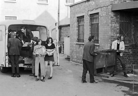 #75014  Bill Murphy (white jacket) and John Howard lifting table.  Moving equipment and books into the building, Liverpool Fr...