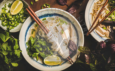 Flat-lay of Vietnamese rice noodle and chicken soup Pho Ga
