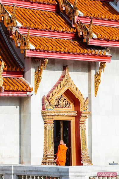 Buddhist monk entering in the temple, Bangkok, Thailand