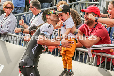 Athlete kisses child by finish line Ironman Barcelona