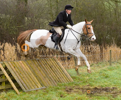 Martin Reason jumping a hunt jump at Peakes - The Fitzwilliam Hunt visit the Cottesmore at Burrough House