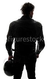 A silhouette of a mystery man in biker Leathers, standing and holding a helmet – shot from eye level.